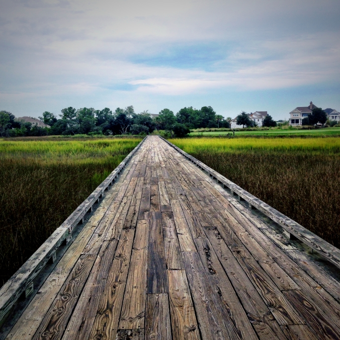 The long wooden bridge crossing the marsh of the 230 yard Par 3 #9
